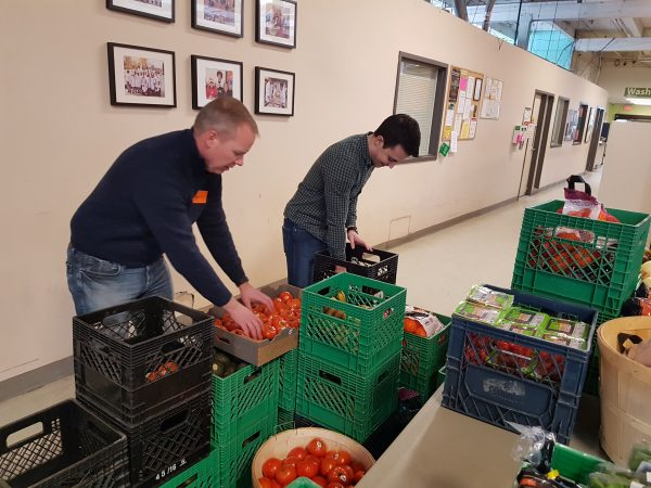 smartprint employees helping sort food items at daily bread